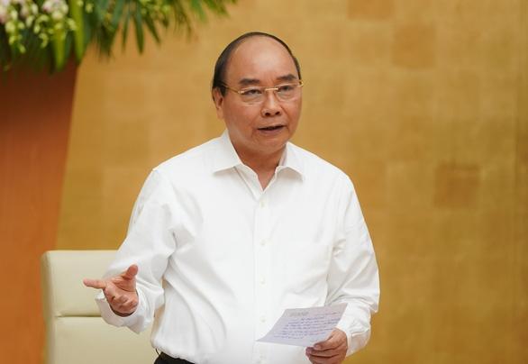 Thủ tướng: Phấn đấu đạt mức tăng trưởng 2,5-3%, tháo gỡ từng dự án - Ảnh 1.