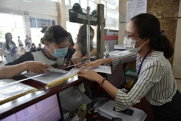 Sắp thí điểm hoàn thuế thu nhập cá nhân điện tử tại TP.HCM - Ảnh 1.