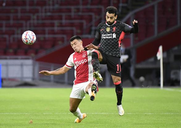 Hậu vệ Ajax phản lưới nhà giúp Liverpool có chiến thắng tối thiểu - Ảnh 3.