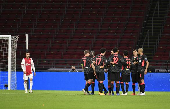 Hậu vệ Ajax phản lưới nhà giúp Liverpool có chiến thắng tối thiểu - Ảnh 1.