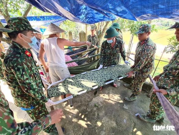 NÓNG: Những hình ảnh đầu tiên của nạn nhân vụ sạt lở ở Trà Leng - Ảnh 6.