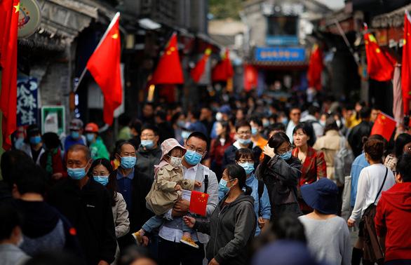 Nửa tỉ người Trung Quốc đi du lịch sau gần 1 năm cách ly, phong tỏa - Ảnh 1.