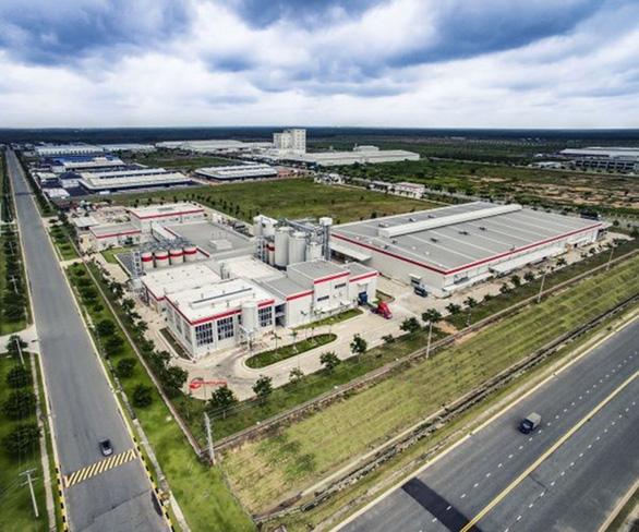 Anheuser-Busch InBev Việt Nam ưu tiên gạo Việt, sử dụng năng lượng tái tạo - Ảnh 1.