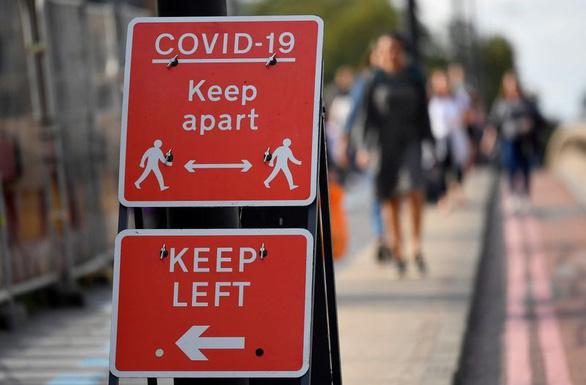 Anh tính nối bước Pháp, Đức phong tỏa toàn quốc ngăn COVID-19 - Ảnh 1.