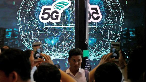 Đấu giá mạng 5G thu tiền tỉ - Ảnh 1.