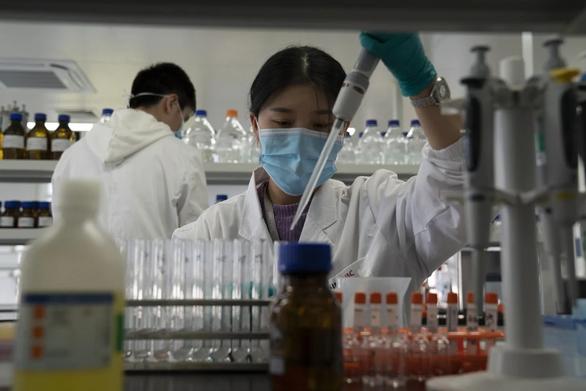 Trung Quốc ký thỏa thuận cung cấp vắc xin ra toàn cầu - Ảnh 1.