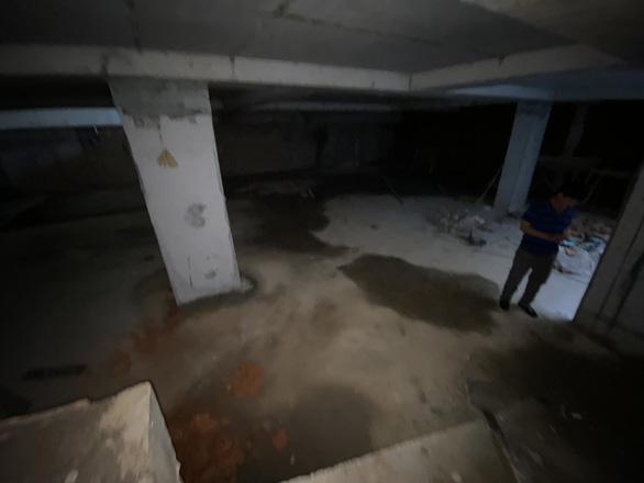 Chủ tịch quận Ba Đình: Nhà phố 5 tầng nổi có 4 tầng hầm 'phù hợp với quy định' - Ảnh 1.