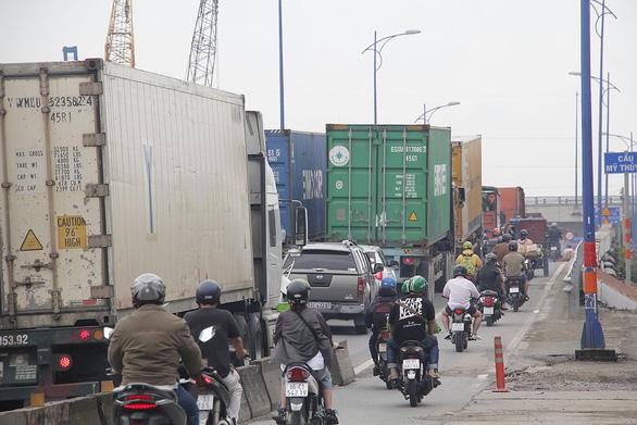 TP.HCM thu phí hạ tầng, thông đường vào cảng - Ảnh 1.