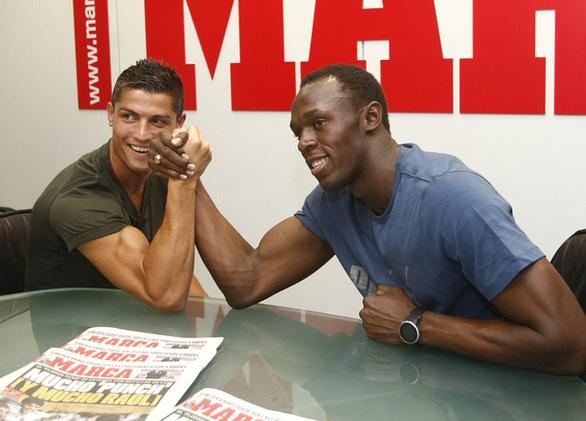 Usain Bolt: Ronaldo chạy nhanh hơn tôi - Ảnh 1.