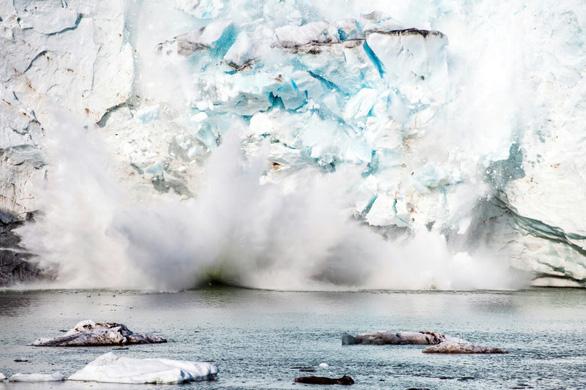 Sông băng ở Greenland tan nhanh hơn dự báo, làm tăng mực nước biển - Ảnh 1.