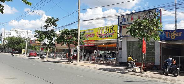 Không chịu chung tiền bảo kê, quán ăn ngay trung tâm TP Vĩnh Long bị đập phá - Ảnh 3.