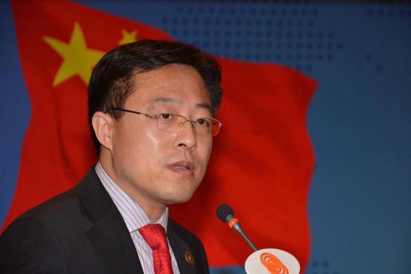 Trung Quốc đe chọc mù mắt nhóm Ngũ Nhãn - Ảnh 1.