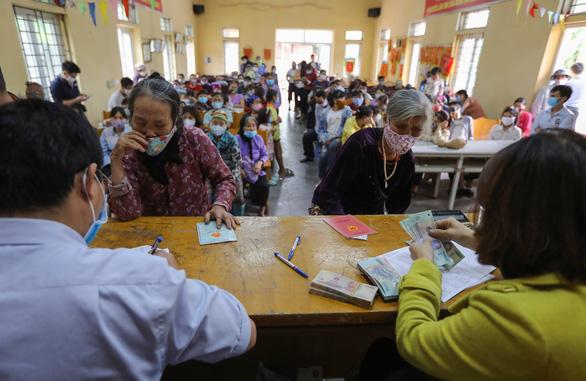 115 hộ dân ở Hà Nội phải trả lại 280 triệu tiền hỗ trợ COVID-19 vì không nghèo - Ảnh 1.