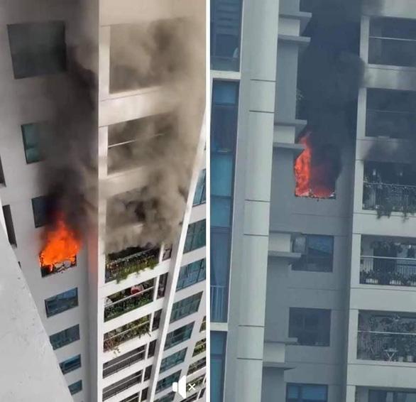Cháy chung cư cao cấp Goldmark City, cư dân tháo chạy xuống đất - Ảnh 1.