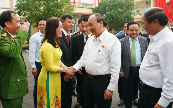 Thủ tướng Nguyễn Xuân Phúc: Giữ tăng trưởng dương, nâng vị thế của Việt Nam - Ảnh 1.
