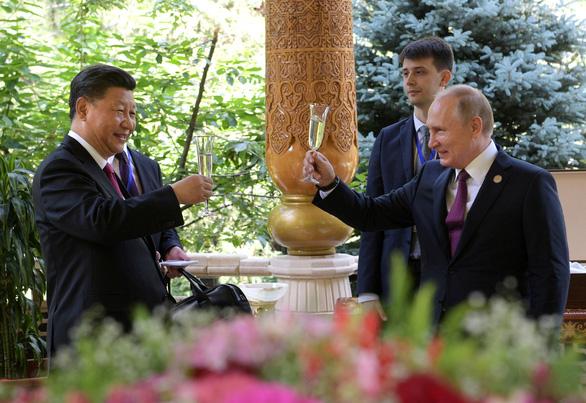 Nga - Trung sẽ xích lại gần nhau hơn khi ông Biden làm tổng thống Mỹ? - Ảnh 1.