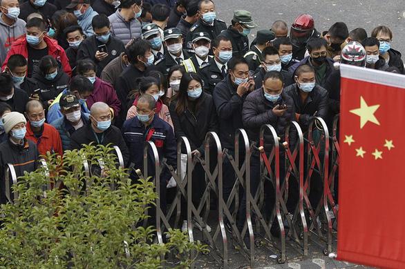 Xuất hiện ca COVID-19 trong cộng đồng, Trung Quốc xét nghiệm hàng triệu người - Ảnh 1.