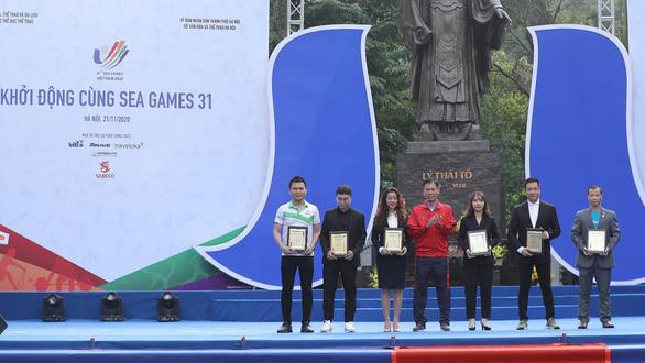 Herbalife Việt Nam tài trợ đồng hành cùng chương trình khởi động SEA Games 31 - Ảnh 1.