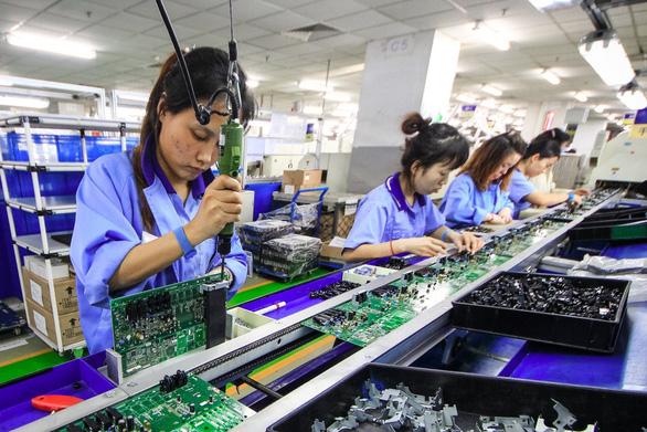 Chuỗi sản xuất rời Trung Quốc tiếp tục dù ông Trump hay Biden làm tổng thống Mỹ - Ảnh 1.