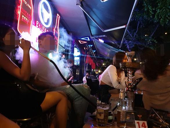 Công an TP.HCM xử lý ồn ào, lấn chiếm ở đại lộ bia Phạm Văn Đồng - Ảnh 1.