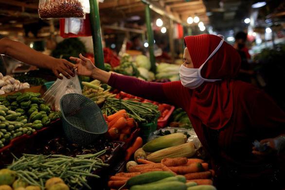 Indonesia chính thức rơi vào suy thoái kinh tế do dịch COVID-19 - Ảnh 1.