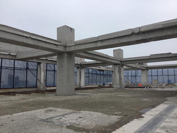 Hà Nội báo cáo Thủ tướng đã cắt ngọn xong tòa nhà 8B Lê Trực - Ảnh 1.