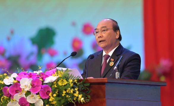 Thủ tướng Nguyễn Xuân Phúc: Không thử thách nào dân tộc ta không thể vượt qua - Ảnh 1.