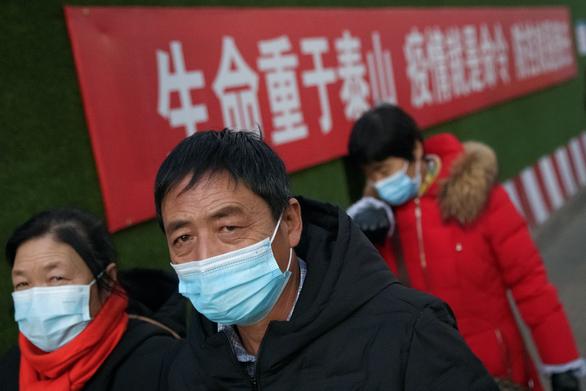 Trung Quốc quay đầu ủng hộ tiền mặt, đòi trừng phạt ai không nhận tiền mặt - Ảnh 1.