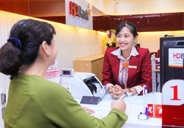 Ngân hàng tung khuyến mãi cho khách hàng nhận kiều hối cuối năm - Ảnh 1.