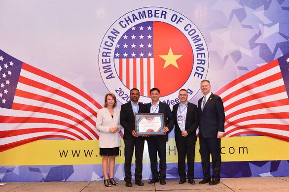 P&G Việt Nam 4 năm liền đạt giải thưởng Trách nhiệm Xã hội Doanh nghiệp từ AmCham - Ảnh 1.