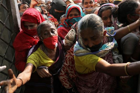 Nhìn lại 2020: Toàn thế giới nghèo đi vì đại dịch COVID-19 - Ảnh 6.