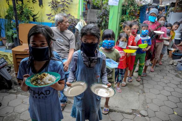 Nhìn lại 2020: Toàn thế giới nghèo đi vì đại dịch COVID-19 - Ảnh 2.