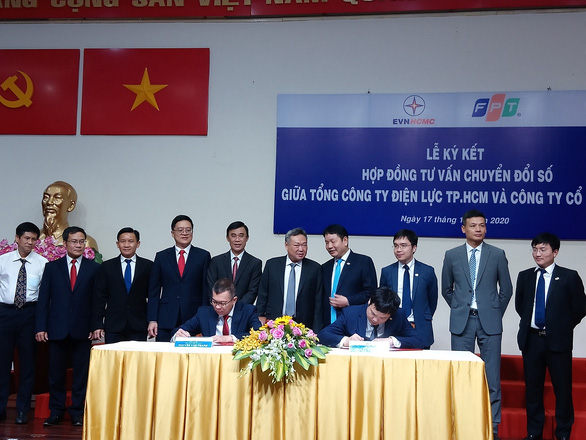 EVNHCMC và FPT ký hợp đồng tư vấn xây dựng lộ trình chuyển đổi số - Ảnh 1.