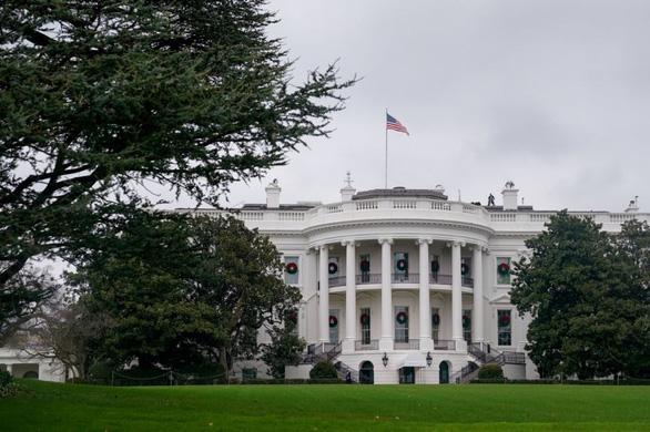 Bộ Tư pháp Mỹ điều tra vụ hối lộ để được ân xá trước khi ông Trump rời Nhà Trắng - Ảnh 1.
