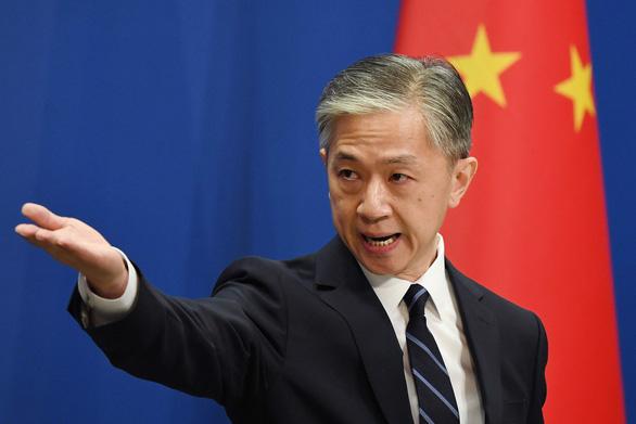 Trung Quốc: Ông Trump cáo buộc Bắc Kinh tấn công mạng là trò hề - Ảnh 1.