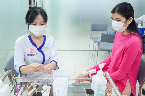 VNVC khai trương trung tâm tiêm chủng quận 7 - Ảnh 2.