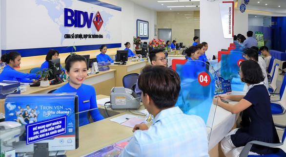 BIDV: Chuyển đổi số để cùng khách vay biến thách thức thành cơ hội - Ảnh 1.
