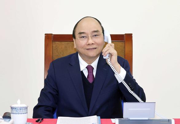 Thủ tướng Nguyễn Xuân Phúc trao đổi với Tổng thống Donald Trump về 'thao túng tiền tệ' - Ảnh 1.