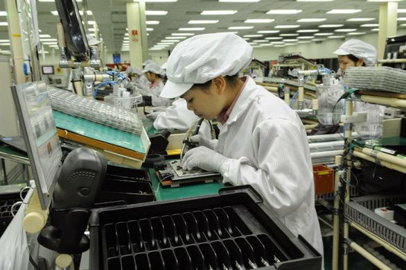 Cơn sóng đầu tư đang đổ dồn về Việt Nam - Ảnh 1.