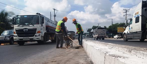 Thông xe cầu Mỹ Quý và Rạch Miễu giải quyết kẹt xe trên quốc lộ 1 - Ảnh 1.