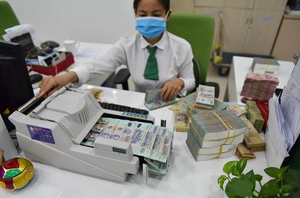 Các ngân hàng đã đồng thuận giảm lãi suất cho vay - Ảnh 1.