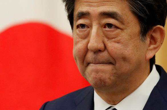 Cựu thủ tướng Nhật Abe Shinzo bị điều tra vì vi phạm quỹ chính trị - Ảnh 1.