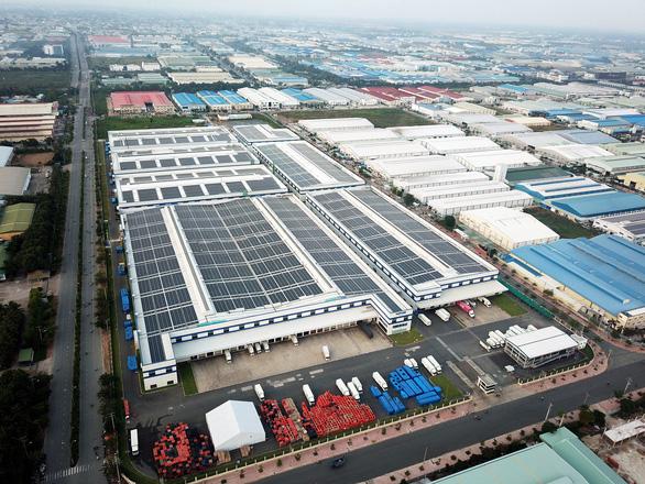Điện mặt trời mái nhà chia sẻ áp lực với ngành điện - Ảnh 1.