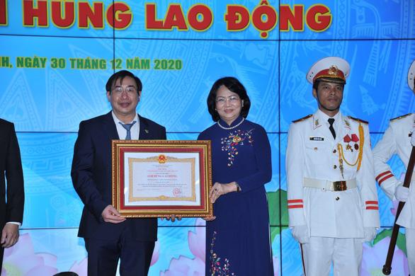 Trường ĐH Y khoa Phạm Ngọc Thạch nhận danh hiệu anh hùng lao động - Ảnh 1.