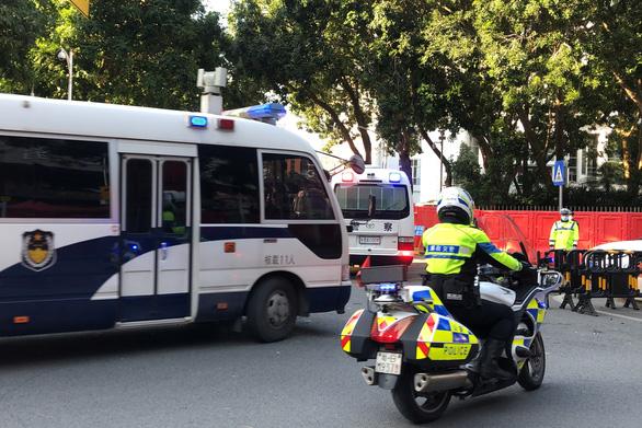 Bất chấp Mỹ can thiệp, tòa Trung Quốc tuyên án tù với 10 người trốn khỏi Hong Kong - Ảnh 1.