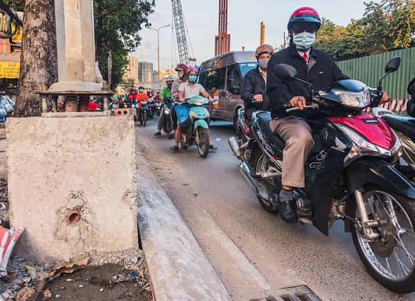 Nâng đường Nguyễn Hữu Cảnh: đã tính phương án không để dân thiệt - Ảnh 2.