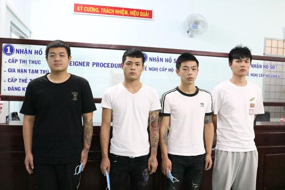 Trục xuất 4 người Trung Quốc nhập cảnh trái phép - Ảnh 1.