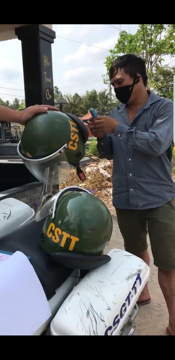 Làm rõ nghi vấn cảnh sát trật tự ở Đồng Nai quay clip tố cáo xe gửi sếp - Ảnh 2.