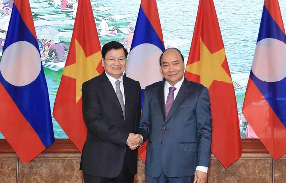 Đánh giá thành tựu nổi bật trong quan hệ Việt - Lào - Ảnh 1.