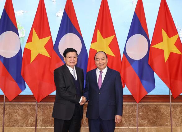 Việt Nam, Lào khẳng định phối hợp, ủng hộ nhau trên các diễn đàn quốc tế - Ảnh 1.